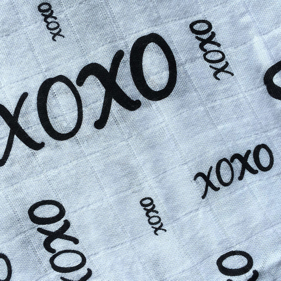 Komo Bebe Chic Muslin Swaddle Blanket - xoxo design closeup